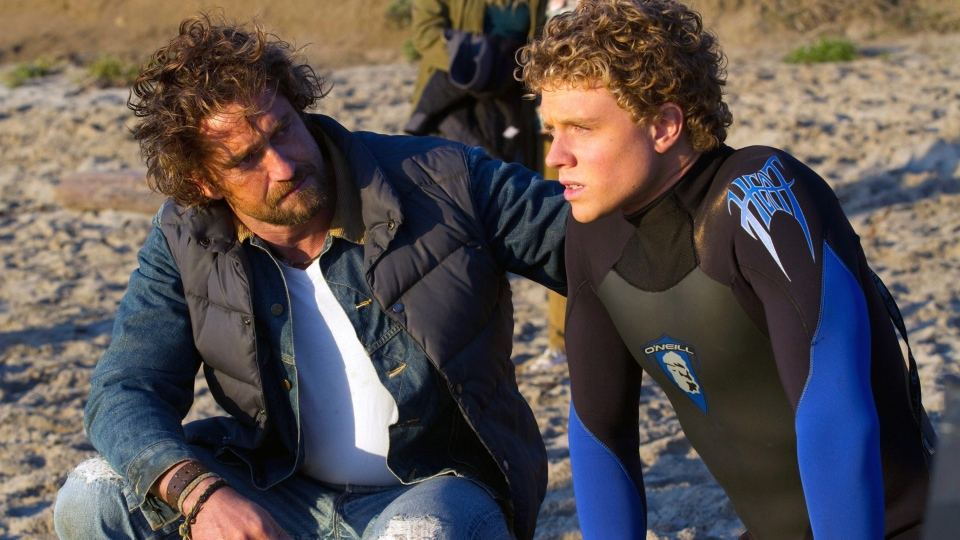 "Gerard Butler, left, and Jonny Weston in a scene from Twentieth Century Fox's ""Chasing Mavericks."""