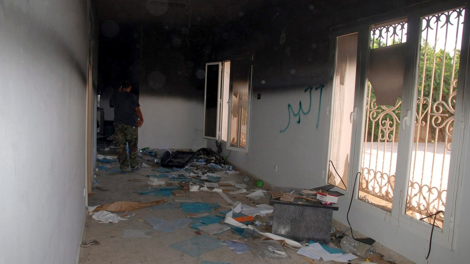 A man walks through a room in the gutted U.S. consulate, after an attack that killed four Americans, including Ambassador Chris Stevens, in Benghazi, Libya, Sept. 12, 2012. (AP / Ibrahim Alaguri)
