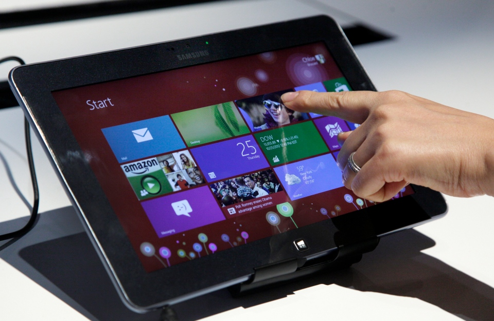 A person tries a Samsung tablet computer running Windows 8 at the launch of Microsoft Windows 8, in New York, Thursday, Oct. 25, 2012. (AP / Richard Drew)