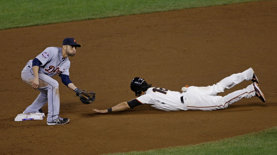 San Francisco Giants' Angel Pagan steals second with Detroit Tigers' Omar Infante covering during the eighth inning of Game 2 of baseball's World Series in San Francisco, Thursday, Oct. 25, 2012. (AP / Jeff Chiu)