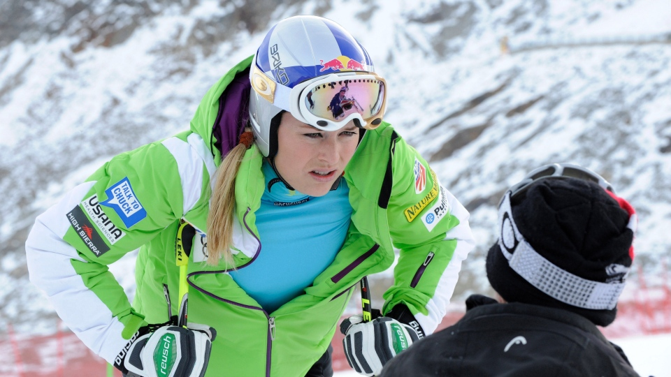Lindsey Vonn speaks with a trainer during a course inspection on the glacier of Soelden, in Austria, on Friday, Oct. 26, 2012.  (AP / Giovanni Auletta)