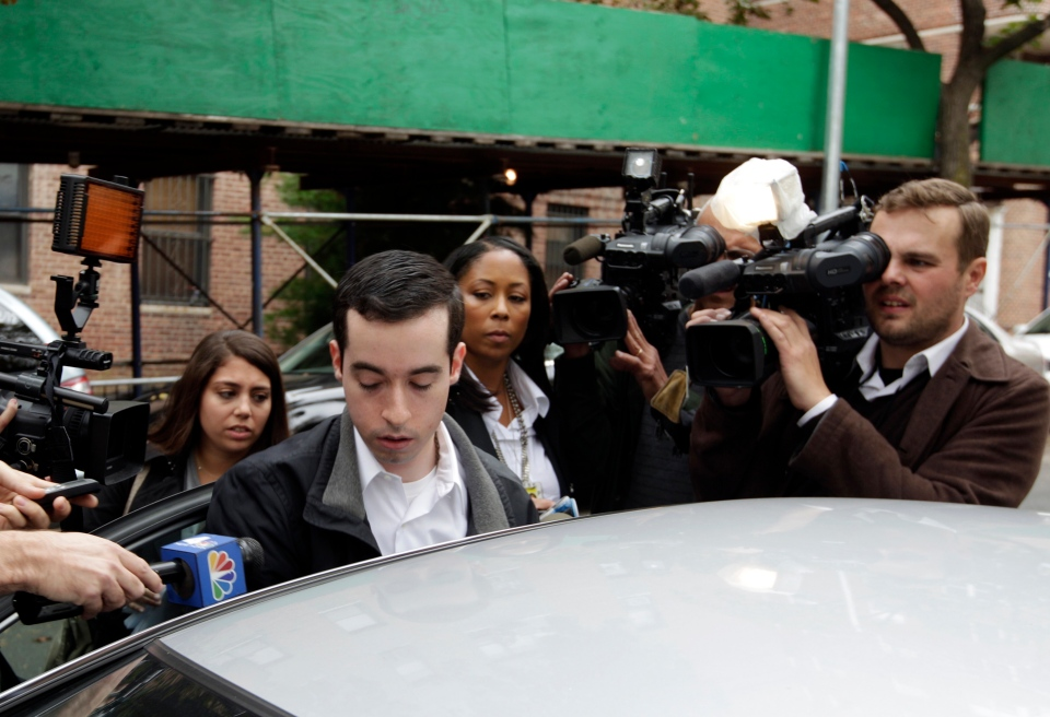 A man claiming to be the brother of New York City Police Officer Gilberto Valle is questioned by the media in the Queens borough of New York, Thursday, Oct. 25, 2012. (AP / Frank Franklin II)