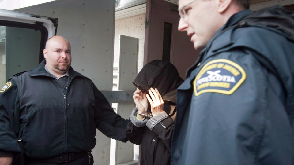 Melissa Ann Weeks, 77, of New Glasgow, N.S., also known as the Internet Black Widow, leaving provincial court from a bail hearing at the Sydney Justice Centre in Sydney, N.S. on Friday, Oct.11, 2012. (Murdock Smith / THE CANADIAN PRESS)