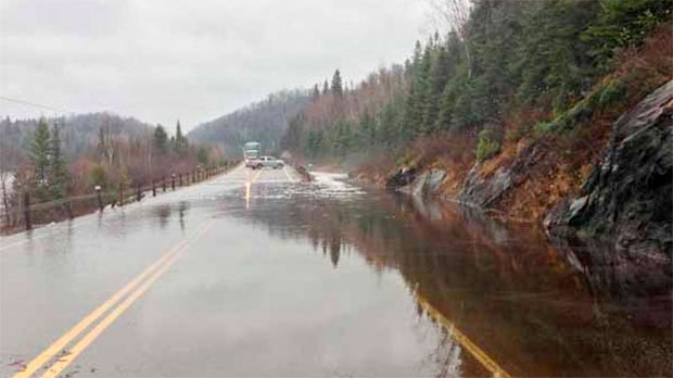 In this image courtesy of Brenda Grundt at wawa-news.com, water floods Highway 17 in Wawa, Ont.
