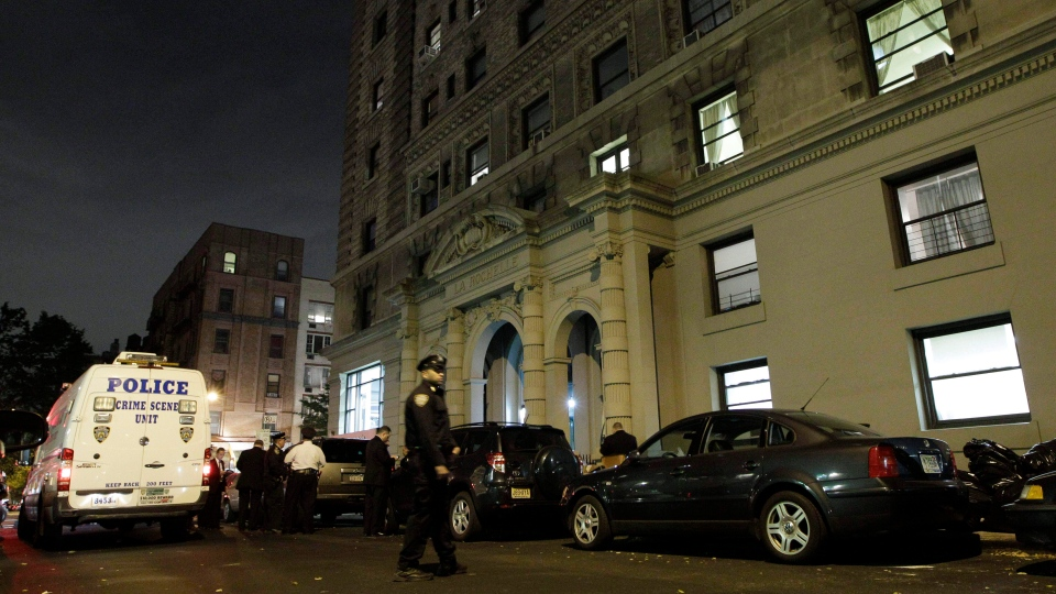 A police crime scene vehicle is parked in front of the luxury Manhattan apartment building where police say a nanny stabbed two small children to death in a bathtub and then stabbed herself in New York, Thursday, Oct. 25, 2012. (AP / Kathy Willens)