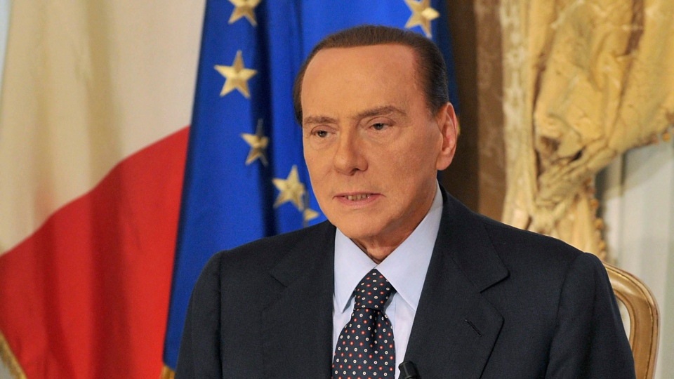 Former Italian Prime Minister Silvio Berlusconi tapes a video message where he announces he will not run for a fourth term as premier in spring elections, Thursday, Oct. 25, 2012. (Livio Anticoli / Berlusconi press office)