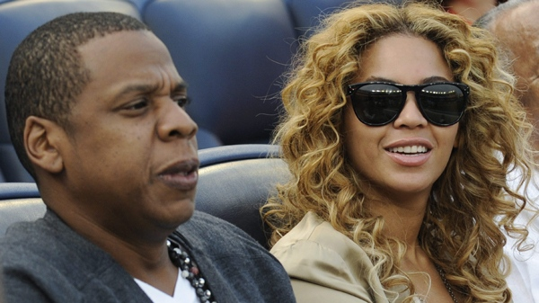Entertainers Jay-Z, left, and Beyonce watch a baseball game between the New York Yankees and Minnesota Twins Friday, May 14, 2010 at Yankee Stadium in New York. (AP Photo/Bill Kostroun)