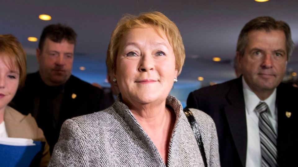 Quebec Premier Pauline Marois walks to a pre-session caucus meeting Thursday, October 25, 2012 in Drummondville. The legislature will resume on Tuesday Oct. 30 with a new elected government. THE CANADIAN PRESS/Jacques Boissinot