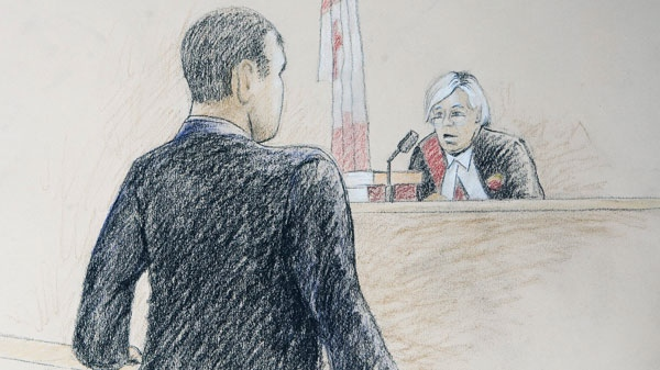 Col. Russell Williams is shown in a sketch as he addresses the court in Belleville, Ont., on Thursday, October 21, 2010. (Tammy Hoy /THE CANADIAN PRESS)