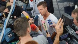 Austria's Felix Baumgartner speaks to journalists after a press conference in Salzburg, Austria on Saturday, Oct. 27, 2012 . (AP / Kerstin Joensson)