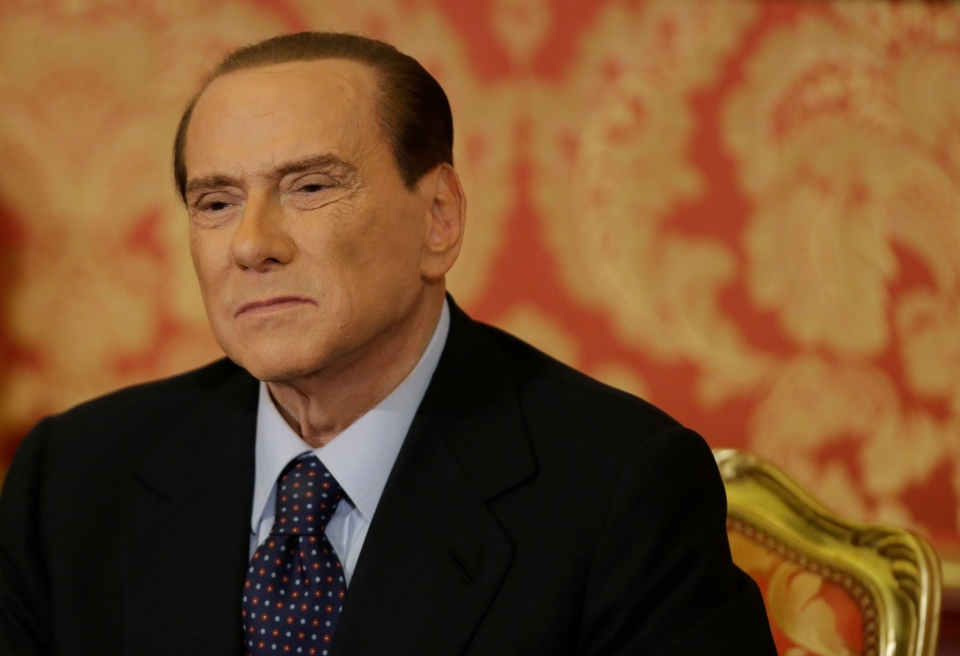 Former Italian premier Silvio Berlusconi grimaces during a press conference in Gerno, near Milan on Saturday, Oct. 27, 2012. (AP / Luca Bruno)