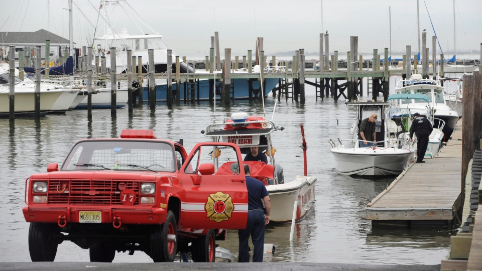 As Hurricane Sandy moves up the East Coast, members of the Highlands Fire Department remove the rescue boat from the Atlantic Highlands Marina in Atlantic Highlands, N.J., Friday Oct. 26, 2012. (AP / Joe Epstein)