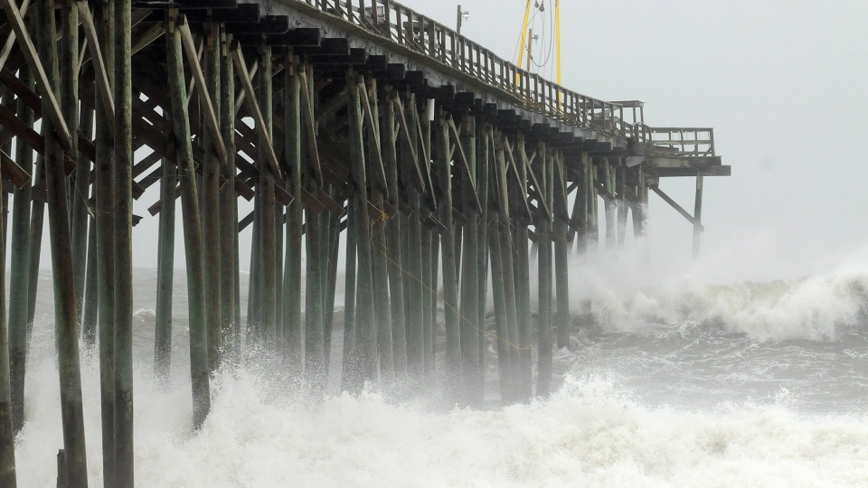 Waves pound Carolina Beach pier in Carolina Beach, N.C., Saturday, Oct. 27, 2012. (AP / The Star-News, Ken Blevins)