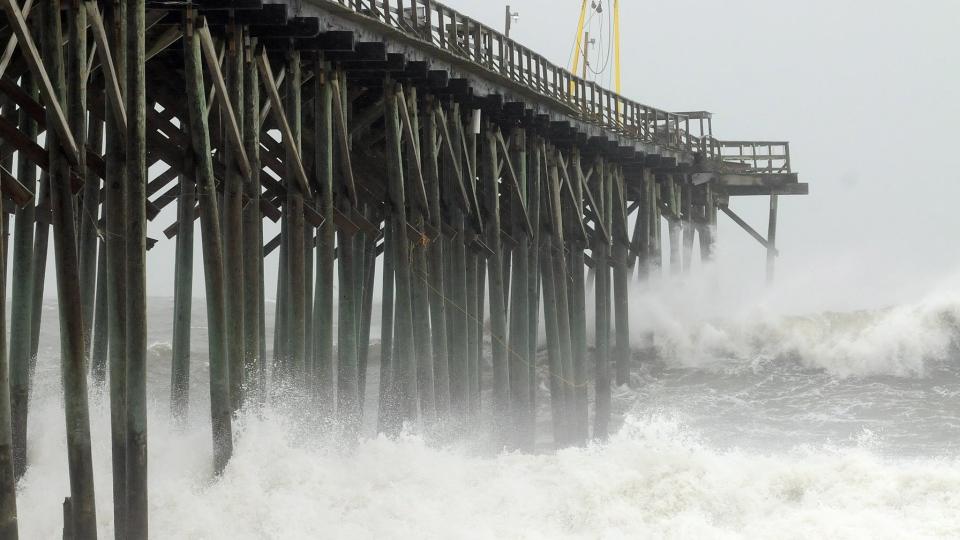 Waves pound Carolina Beach pier in Carolina Beach, N.C., Saturday, Oct. 27, 2012. (AP / The Star-News, Ken Blevins)