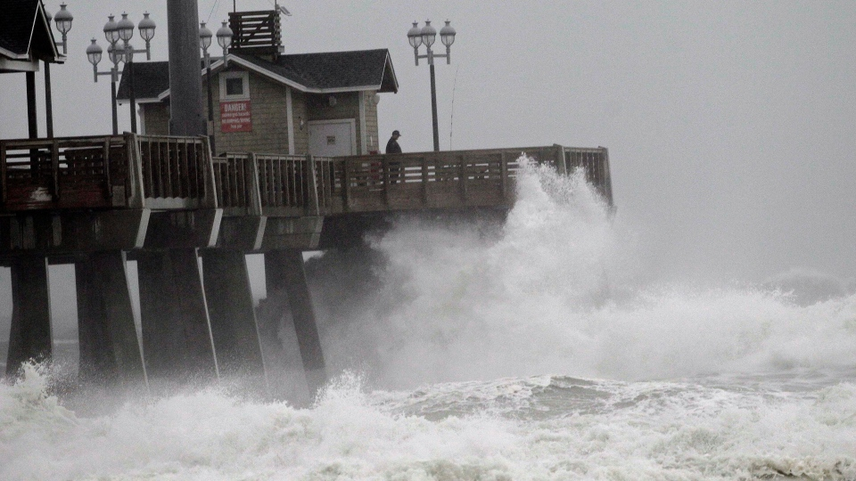 Large waves generated by Hurricane Sandy crash into Jeanette's Pier in Nags Head, N.C., Saturday, Oct. 27, 2012. (AP / Gerry Broome)