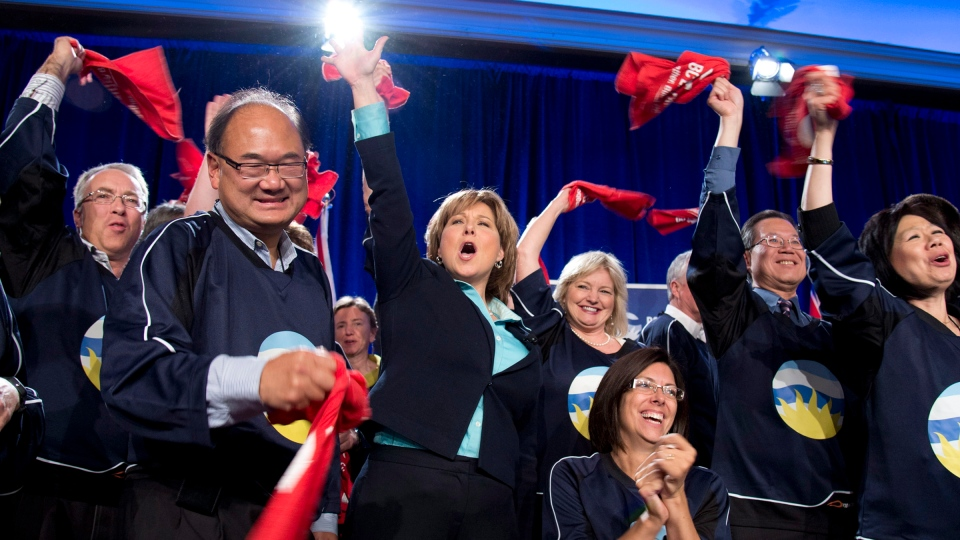 British Columbia Premier Christy Clark, centre, cheers after she addressed fellow Liberals during the B.C. Liberal Convention in Whistler, B.C., Saturday, Oct. 27, 2012. (Jonathan Hayward / THE CANADIAN PRESS)