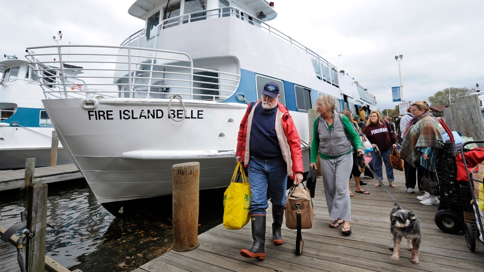 Passengers depart one of the last ferries from the Fire Island communities in preparation for the arrival of Hurricane Sandy in Bay Shore, N.Y. on Sunday, Oct., 28, 2012. (AP / Kathy Kmonicek)