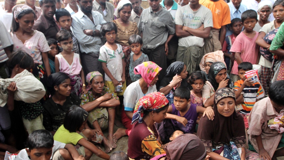 Muslim refugees gather at Thechaung camp refugee camp upon arrival in Sittwe, Rakhine State, western Myanmar, Sunday, Oct. 28, 2012. (AP / Khin Maung Win)