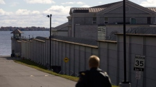 A guard patrols outside Kingston Penitentiary in Kingston, Ont., on Thursday, Oct. 21, 2010. (Lars Hagberg / THE CANADIAN PRESS)