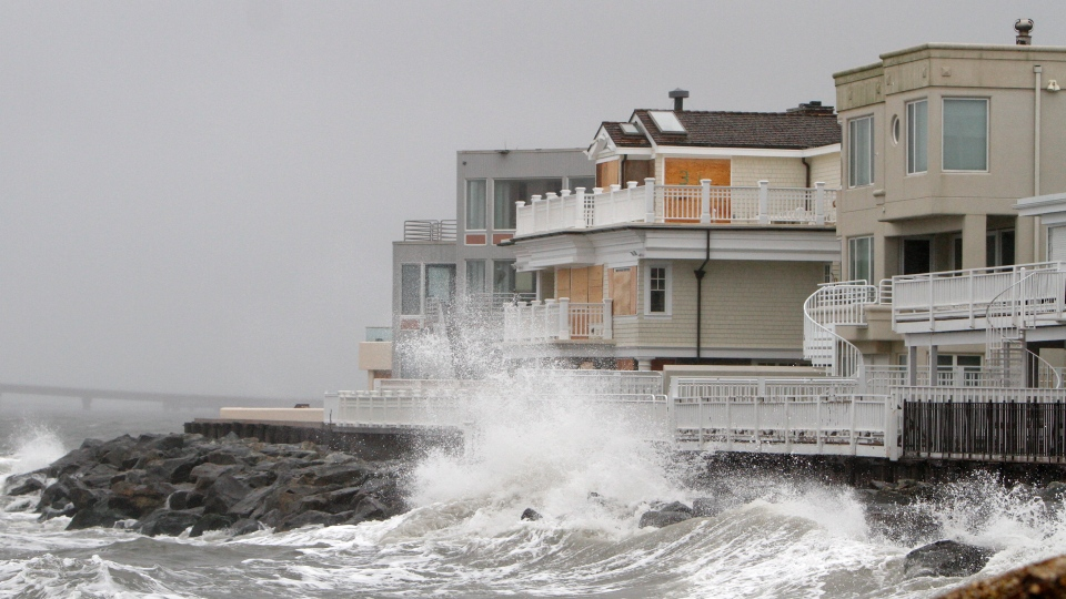 Waves crash onto the sea wall protecting homes in Longport, N.J., Sunday, Oct. 28, 2012. (AP / Joseph Kaczmarek)