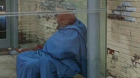 A homeless woman tries to sleep at a Dundas Ave. W. transit shelter on Saturday, Oct. 9, 2010. (Bill Doskoch/ctvtoronto.ca)