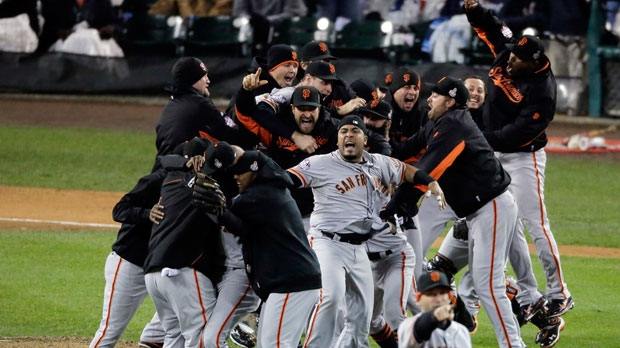 San Francisco Giants celebrate after the Giants defeated the Detroit Tigers in Game 4 of baseball's World Series Sunday, Oct. 28, 2012, in Detroit. The Giants won the World Series 4-0. (AP Photo/Charlie Riedel)