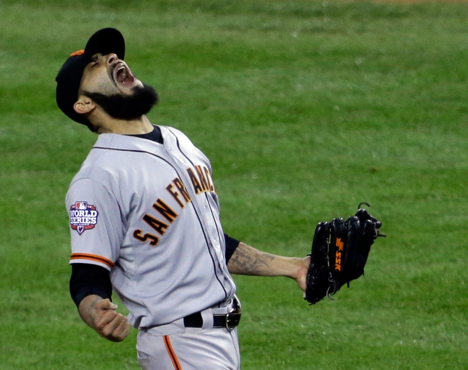 San Francisco Giants' Sergio Romo reacts after striking out Detroit Tigers' Miguel Cabrera in the 10th inning of Game 4 of baseball's World Series Sunday, Oct. 28, 2012, in Detroit. The Giants won the game 4-3 to win the World Series. (AP Photo/Patrick Semansky)