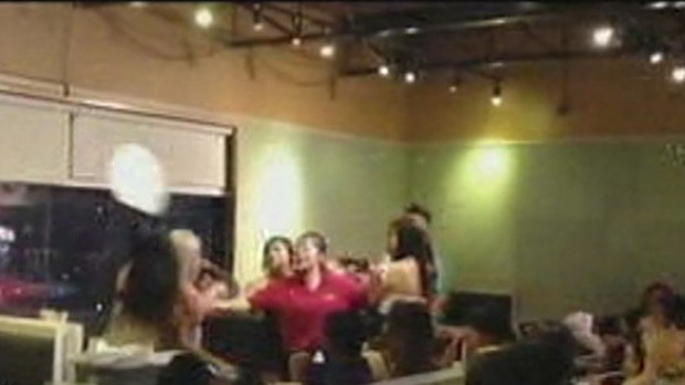 A woman was hit in the face with a plate during a brawl inside a Chinatown restaurant early Saturday, Oct. 27, 2012. (YouTube)