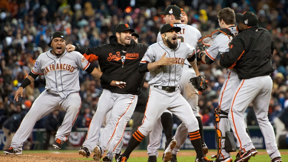 The San Francisco Giants celebrate defeating the Detroit Tigers in Game 4 of baseball's World Series in Detroit on Sunday, Oct. 28, 2012. (The Sacramento Bee / Paul Kitagaki Jr.)