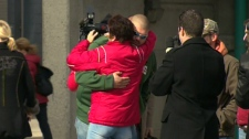 Andy Lloyd, brother of Jessica Lloyd, is greeted by a hug as people arrive for the 'healing event' in Belleville, Ont., Friday, Oct. 22, 2010