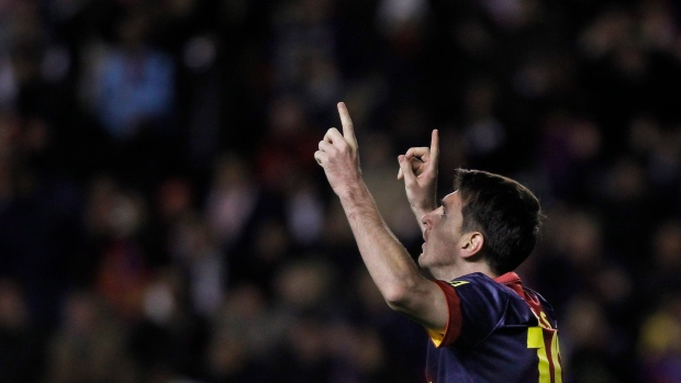 FC Barcelona's Lionel Messi celebrates with team