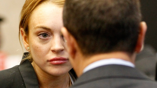 Lindsay Lohan looks at a court official as she arrives for a probation violation hearing at Beverly Hills Courthouse in Beverly Hills, Calif., Friday, Oct. 22, 2010. (AP / Mario Anzuoni)
