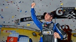 Jimmie Johnson celebrates his win in the NASCAR Sprint Cup Series auto race at Martinsville Speedway, Sunday, Oct. 28, 2012, in Martinsville, Va. (AP / Autostock, Brian Czobat)