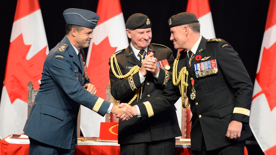 Governor General David Johnston, centre, applauds as outgoing Chief of Defence Staff General Walter Natynczyk, right, and Lieutenant-General Tom Lawson shake hands during the Chief of Defence Staff Change of Command ceremony in Ottawa, Monday Oct. 29, 2012. (Adrian Wyld / THE CANADIAN PRESS)