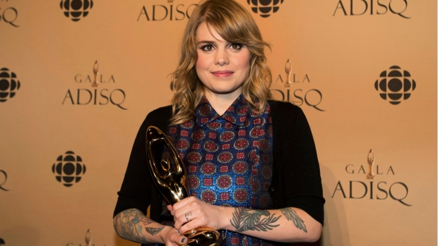 Coeur de pirate holds up her Felix award for best