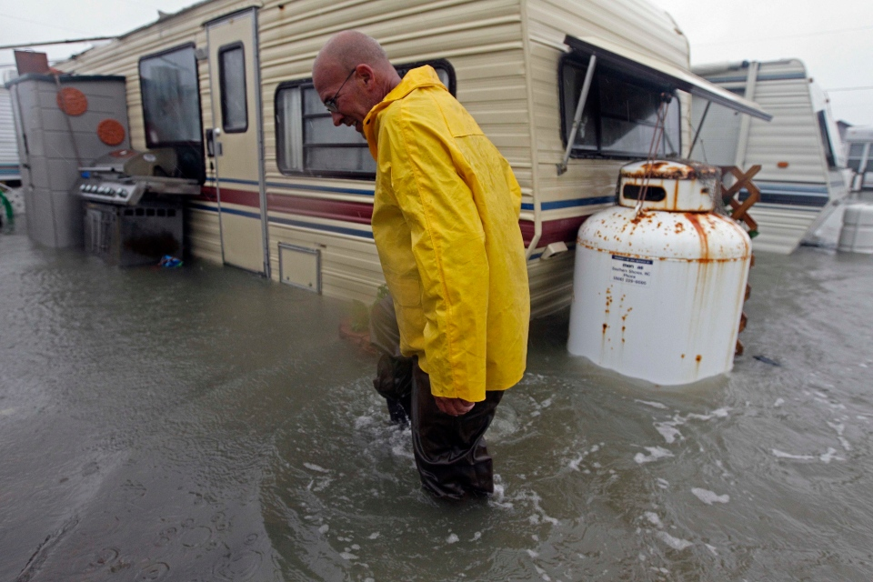 Terry Robinson checks on his flooded trailer at RV Park in Kitty Hawk, N.C., Monday, Oct. 29, 2012. (AP / Gerry Broome)