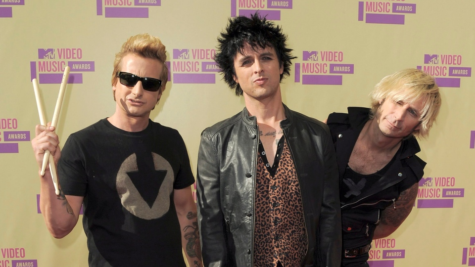 Members of Green Day, from left, Tre Cool, Billie Joe Armstrong and Mike Dirnt attend the MTV Video Music Awards in Los Angeles on Thursday, Sept. 6, 2012. (Jordan Strauss / Invision)