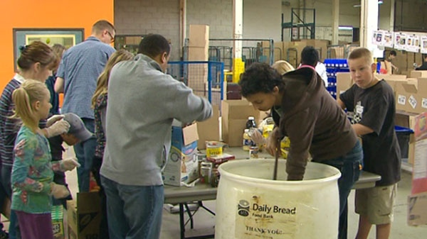 Volunteers help sort food at the Daily Bread food bank warehouse on Thanksgiving weekend, 2010. The food bank didn't reach its goal of 500,000 pounds of food and $500,000.