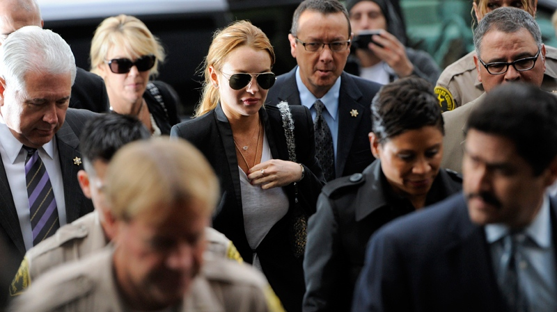 Lindsay Lohan, centre, arrives for a probation violation hearing at Beverly Hills Courthouse in Beverly Hills, Calif., Friday, Oct. 22, 2010. (AP / Chris Pizzello)