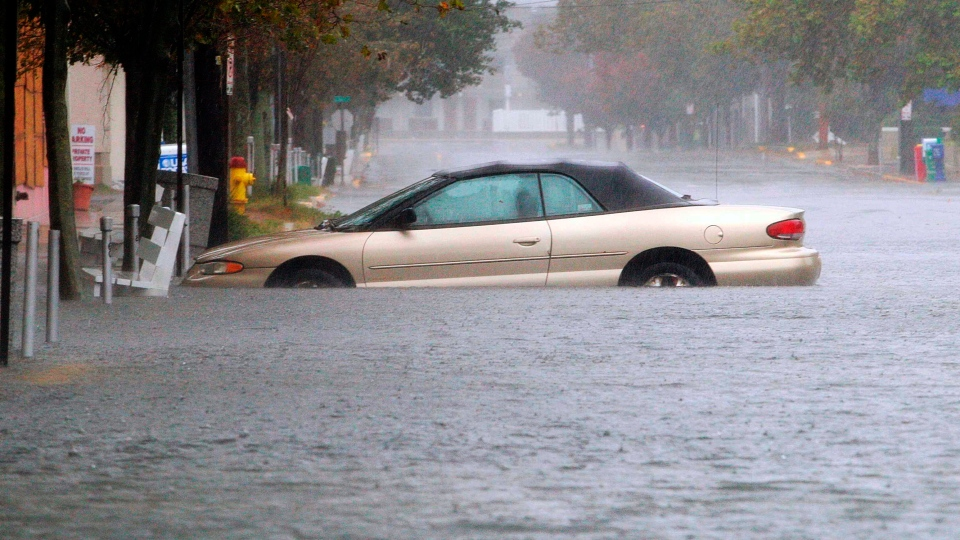 A car is stuck in deep water on Wilmington Avenue in Rehoboth Beach, Del., Monday, Oct. 29, 2012. (The Wilmington News-Journal / Suchat Pederson)