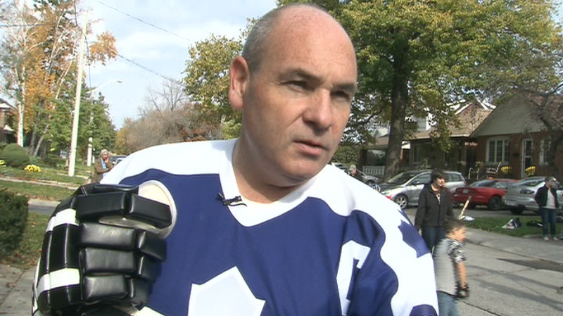 George Smitherman takes a break from road hockey, with just two days left in the Toronto municipal election campaign on Saturday, Oct. 23, 2010.
