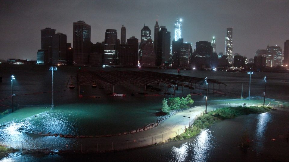 Lower Manhattan goes dark during hurricane Sandy, on Monday, Oct. 29, 2012, as seen from Brooklyn, N.Y. (AP / Bebeto Matthews)