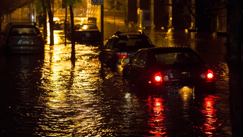 Vehicles are submerged during a storm surge near the Brooklyn Battery Tunnel in New York on Monday, Oct. 29, 2012.  (AP / John Minchillo)