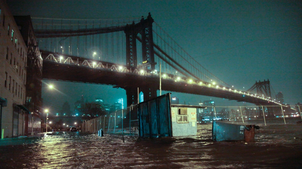Streets are flooded under the Manhattan Bridge in the Dumbo section of Brooklyn, N.Y., Monday, Oct. 29, 2012. (AP/Bebeto Matthews)