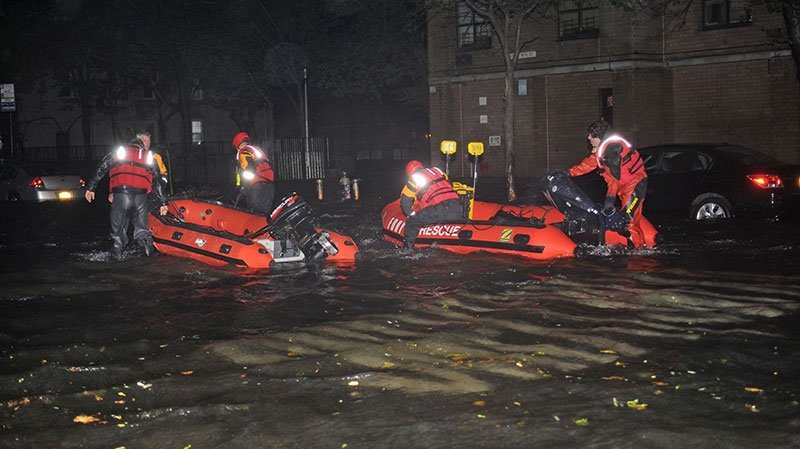 FDNY inflatable boats travel along 14th street towards the East River on a rescue mission in the wake of Hurricane Sandy, in New York, Monday, Oct. 29, 2012. (AP / Louis Lanzano)