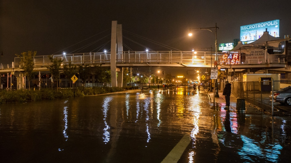 This photo provided by Dylan Patrick shows flooding along the Westside Highway near the USS Intrepid as Sandy moves through the area in New York, Monday, Oct. 29, 2012. (AP/ Dylan Patrick)