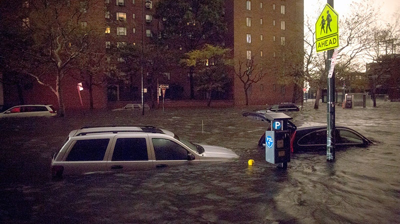 Vehicles are submerged on 14th Street near the Consolidated Edison power plant in New York, Monday, Oct. 29, 2012. (AP / John Minchillo)