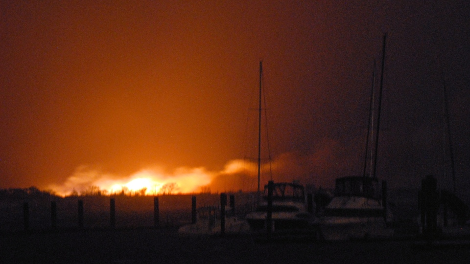 A fire burns at least two dozen homes in a flooded neighbourhood in the New York City borough of Queens on Tuesday, Oct. 30, 2012. (AP / Stephanie Keith)
