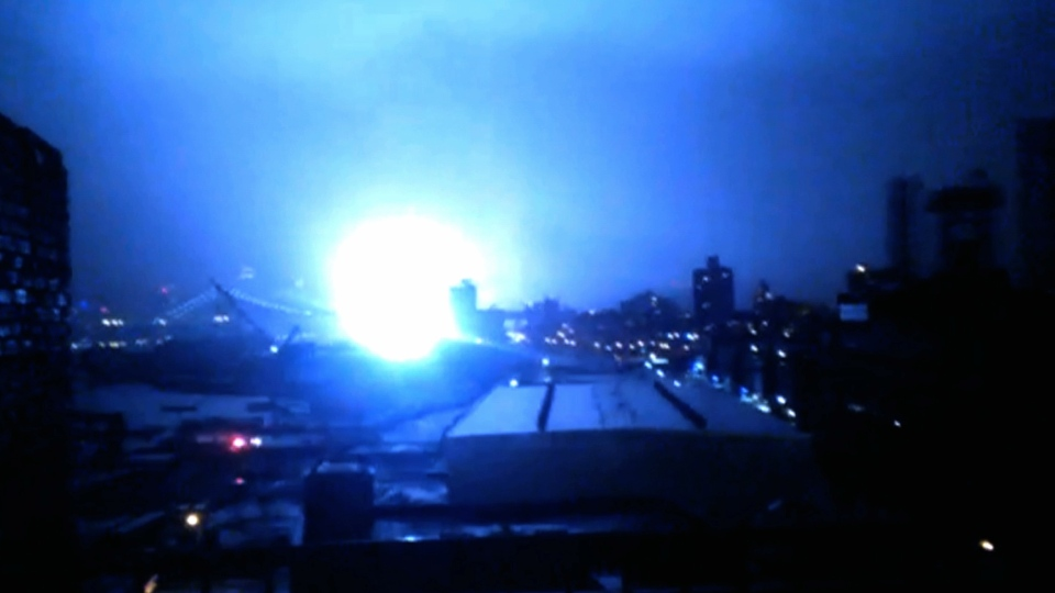 This image from video provided by Dani Hart shows what appears to be a transformer exploding in lower Manhattan as seen from a building rooftop from the Navy Yard in Brooklyn during Sandy's arrival in New York City.