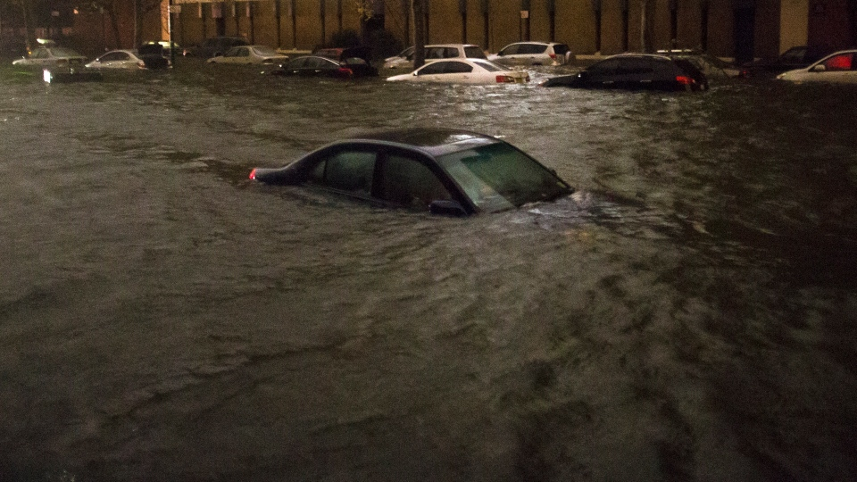 A vehicle is submerged on 14th Street near the Consolidated Edison power plant in New York, late Monday, Oct. 29, 2012. (AP / John Minchillo)